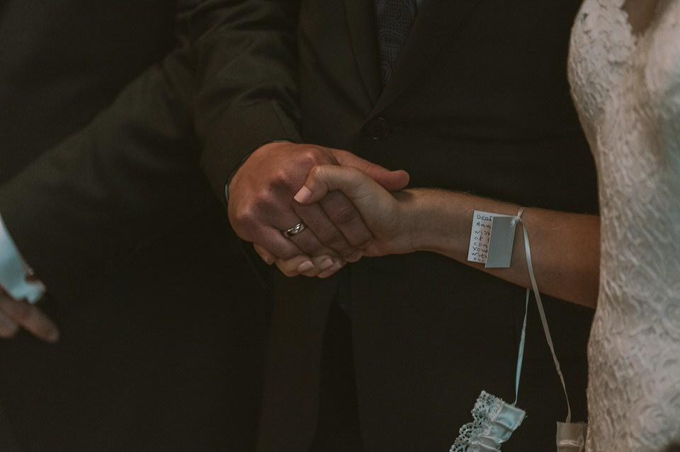 Bride & Groom Clasp Hands