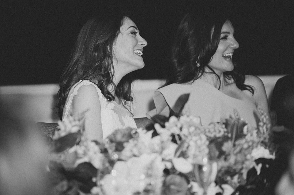 Women Laughing With Flowers