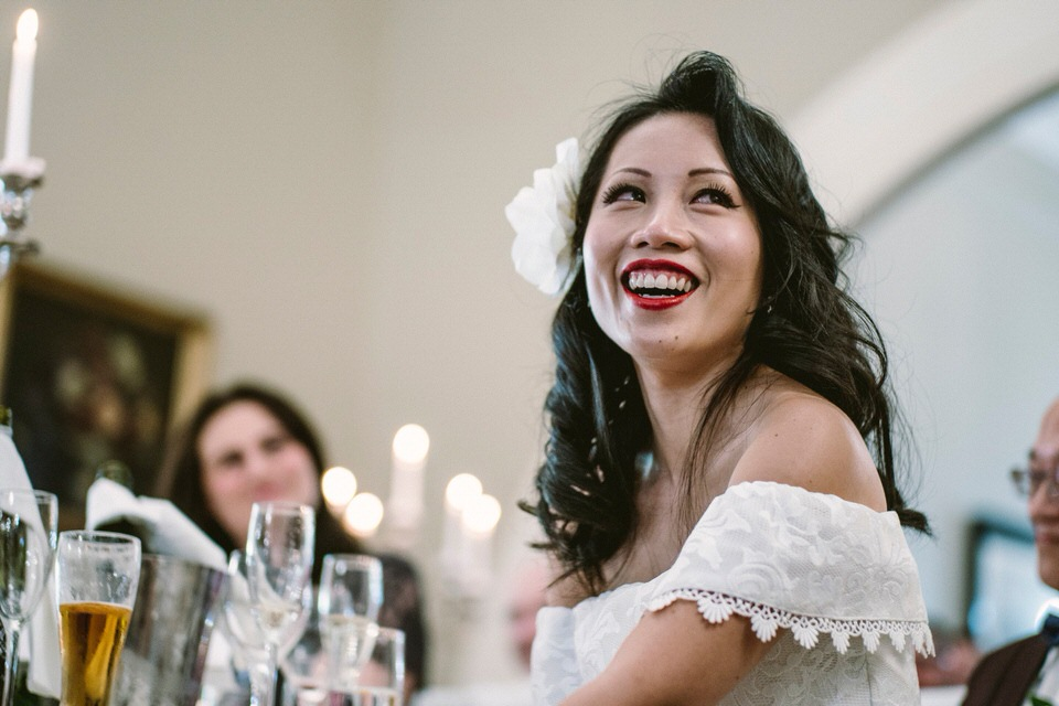 Bride Laughs at Table